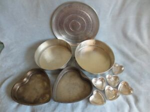 Mixing bowls and cake pans for sale