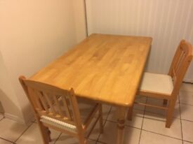 Solid Wood dining table with two dining chairs