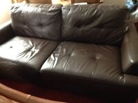 Brown leather sofa needs a good home.