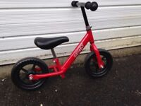 Childs push along bike - ideal way to start on 2 wheels - great condition