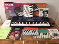Casio Keyboard CTK451 - excellent boxed condition with selection of beginner music books