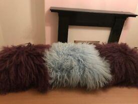 Three fluffy cushions. Suede back