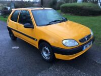 Citroen Saxo 1.1 Forte in yellow cheap small car