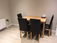 Kitchen table in oak wood effect & 4 black leather effect chairs