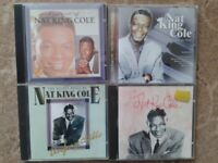 A collection of Nat King Cole CDs