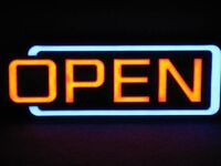 A NEON 'OPEN' SIGN WITH THREE SETTINGS