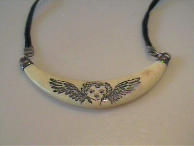 60s -70s Jewelry – Necklaces, Earrings, Rings, Bracelets VINTAGE 1960'S ANGEL CARVED CHOKER CORD NECKLACE WITH SAFETY CLASP  $14.00 AT vintagedancer.com