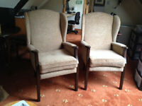A pair of wing backed Parker Knoll armchairs reupholstered in Ross fabric with new seat cushions