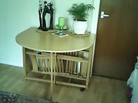 Neat kitchen folding table and 2 chairs.
