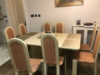 Italian extendable lacquered table and chairs