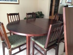 IKEA Dining room table with 2 leaves and 8 chairs.