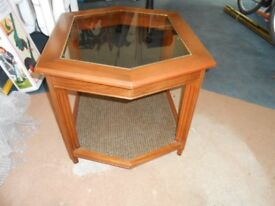 Glass topped coffee table.