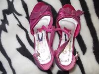 pink,glitter,sandals on a heel,size 34(2 older girls) in excellent condition