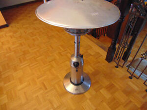 one heat lamp or patio heater Napoleon can put on table or stand