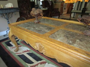 MOVING: One-of-a-kind carved coffee table