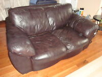 Real leather brown love seat in very good condition