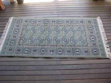 Green Patterned Rug