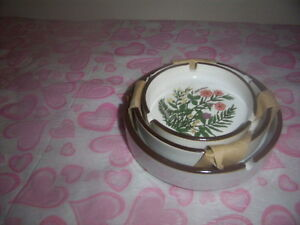 ashtrays with flowers on them.