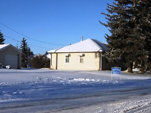 Price Reduced on Corner Commercial lot in Tofield!