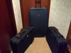 SUITCASES - 1 LARGE AND 2 MEDIUM SIZED WITH WHEELS.