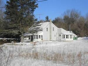 4 bedroom home and garage on 61 acres! Arden $199,000