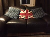 Two seater faux leather sofa - second hand but good condition - darkest brown