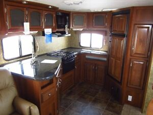 Used 2012 Coachmen Freedom Express Maple Leaf Edition 304RKDS