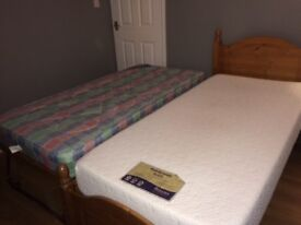 Pine guest bed with mattresses. Very good condition.