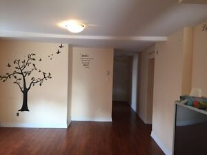 5 1/2 apartment in duplex with basement and private backyard