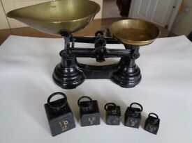 ANTIQUE SCALES WITH CAST WEIGHTS