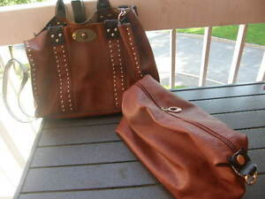Purses and brocaded evening jacket