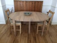 Noah oak extending dining table and two Suffolk natural oak chairs, as new condition