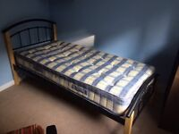 Single bed and matteress wood with black metal head board and foot
