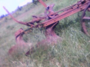 Antique 1 sod and 2 sod plows horse drawn