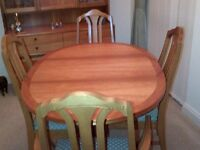 Dining Room Table, 6 Chairs and a Display Cabinet. Nathan/Parker Knoll in excellent condition.