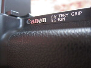 Genuine Original Canon Grip, Charger, and two Batteries