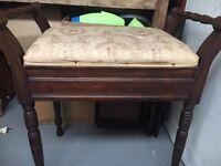 Antique mahogany upholstered piano stool