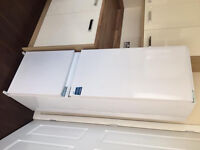 Integrated fridge freezer imaculate condition less than 2 years old