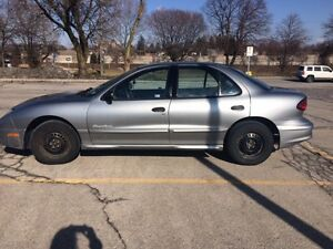2005 Pontiac Sunfire with Free Summer tires on Rims. 1900 OBO