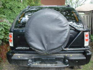 *2000 jimmy spare tire carrier & clear altezza rear lights*