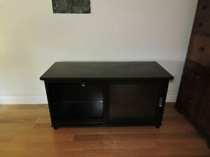 tv stand with glass sliding doors in excellent condition