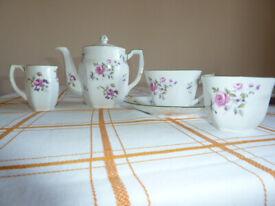 Individual china coffee/tea pot, cup, saucer, jug and sugar bowl
