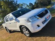 2013 Toyota Hilux TGN16R MY12 Workmate Double Cab 4x2 White 5 Speed Manual Utility Burleigh Heads Gold Coast South Preview
