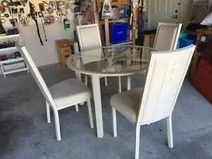 46 inch round glass and metal dining table with 4 chairs