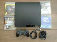 PlayStation 3 Slim with Controller and 4 Games