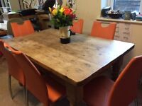 Farmhouse pine dining table sits 6 to 8. Gorgeous turned legs. Looks traditional. Table only