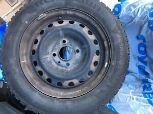 1 year old Winter tires with rims - 185/65R15 4 bolt