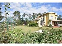 GORGEOUS Home with 11 Acres ONLY 15 min from GP!