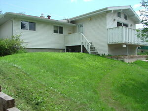 Mayland NE. 3 Bdrm. main floor of house, with garage. June 1st.