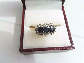 Large size gold ring set with 3 large sapphires and 18 smaller diamonds